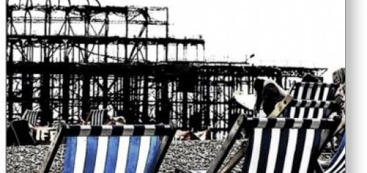 (UK) Empty Deckchairs, burnt Pier Brighton Postcard